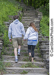 Young Couple Walking Hand In Hand - Young Couple Taking An...