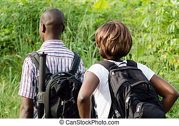 young couple walking in the bush.