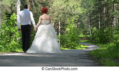 Young couple walking in the square