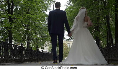 Young couple walking in the square, day