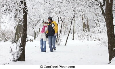 Young couple walking in winter wood