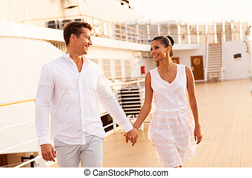 young couple walking on cruise ship - cheerful young couple...