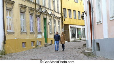 Young couple walking on the date in old city