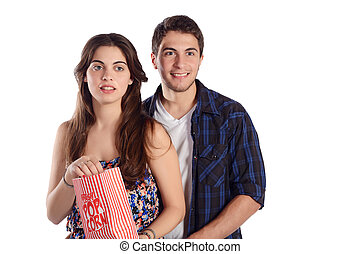 Young couple watching a  movie and eating popcorn.