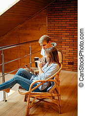 couple watching something on tablet device