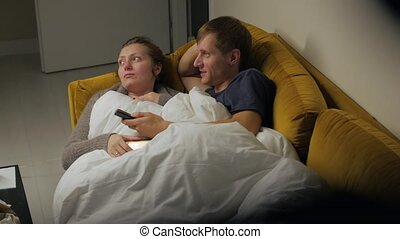 Young Couple Watching TV Talking