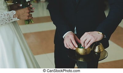 Young couple wear wedding rings to each other