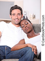 young couple, white man watching us and black woman sleeping...