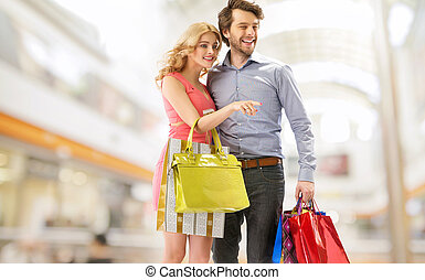Young couple with a bunch of shopping bags