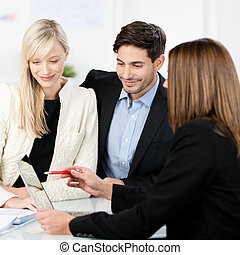 Young couple with a business adviser - Attractive stylish...