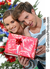Young couple with a Christmas present