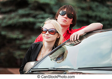 Young couple with a new car
