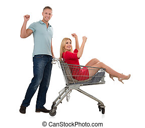 Young Couple With A Shopping Trolley