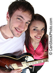 Young couple with an electric guitar