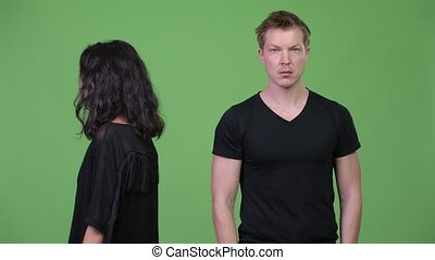 Young couple with arms crossed together - Studio shot of...