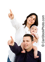 Young couple with baby pointing at copy space.