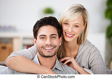 Young couple with beautiful smiles