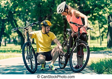 Young couple with bicycles