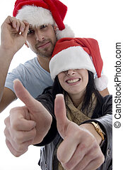 young couple with chritsmas hat