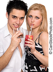 Young couple with cocktails. Isolated