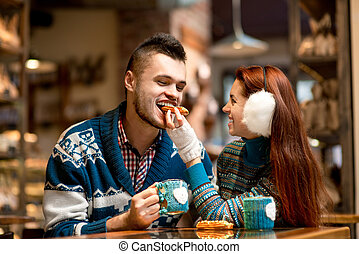 Young couple with coffee at the cafe in winter - Young ...