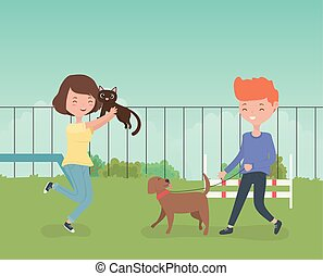 young couple with cute little dog and cat in the field