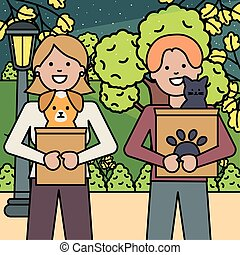 young couple with dog and cat in the park