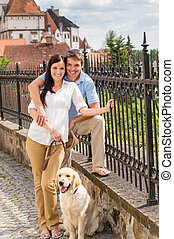 Young couple with dog at historical town - Young couple with...