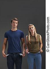 Young Couple With Empty Pockets And No Money
