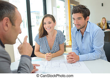 Young couple with estate agent
