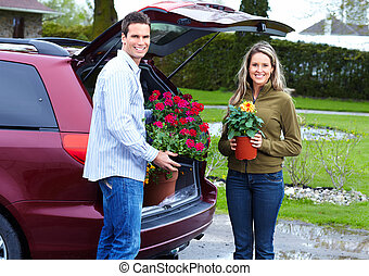 Young couple with flowers.
