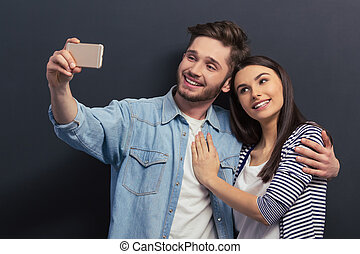 Young couple with gadget