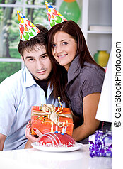 young couple with gifts