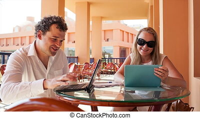 Young couple with laptop and pad
