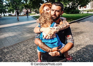 Young couple with little girl on hands