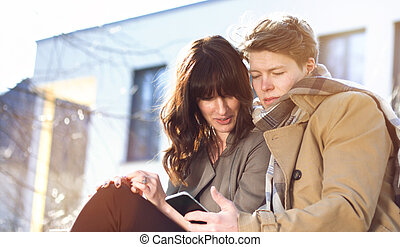 Young couple with mobile phone