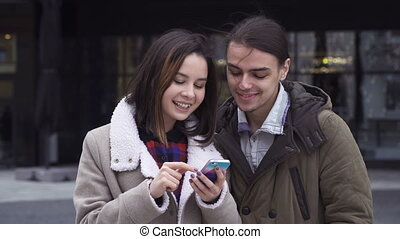Young couple with smart phone