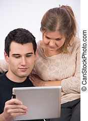 Young couple with tablet-pc