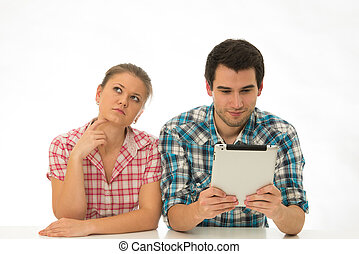 young couple with tablett-pc