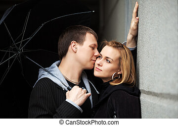 Young couple with umbrella