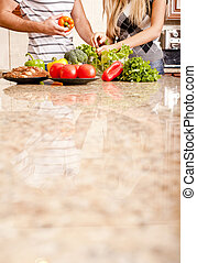 Young Couple with Vegetables