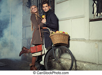 Young couple with wicker basket full of apples