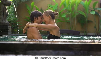 Young couple woman and man have fun in their private...
