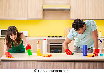 Young couple working at kitchen