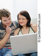 Young couple working on laptop