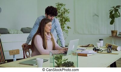 Young couple working together in an office.