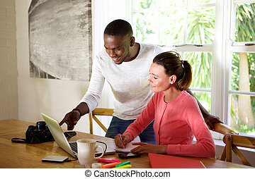 Young couple working together on a laptop