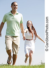 young Couples Running At Park