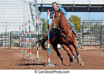 Young Cowboy Pole Bending