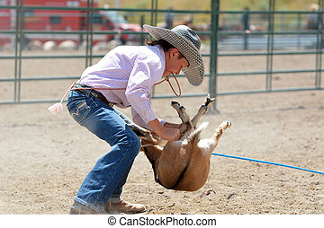 Young Cowboy with Goat
